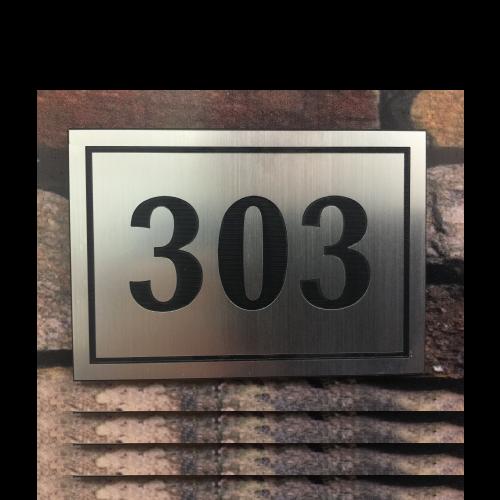 NC200 Numero departamento cromo bruñido grabado bajo relieve 10x7 cms 1